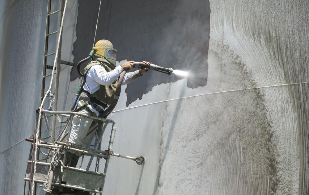 Ozark applicators water tower painting about us for Sandblasting and painting